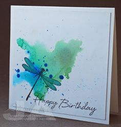 spritz cardstock with water first and dripped a little ink onto it, letting it pool and run.flick some ink for some splatters of more concentrated color. Once dry, stamp dragonfly, use wet brush to lift some of the color from wings Spica glitter pens to give them a shimmery finish