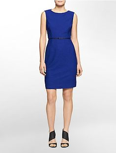 a textured pattern and removable belt details this sleek dress.