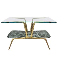 Gio Ponti Style Glass and Marble Bilevel Coffee Table, Italy, 1950s MATERIALS:	Brass, glass, marble HEIGHT:	18.5 in. (47 cm) WIDTH:	30.71 in. (78 cm) DEPTH:	19.49 in. (50 cm)