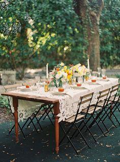 rustic spanish-inspired orange & yellow tablescape | melanie gabrielle photography | via: ruffled