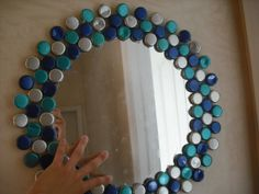 things to make with beer bottle caps | Bottle cap mosaic mirror ...I think it works because of the colors.