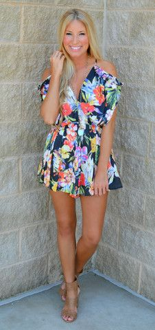 This black floral printed satin romper with cut-out shoulders and ruffle detailing... I'm in love!