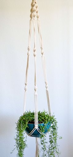 Mahana Macrame Plant Hanger via KnotOnomy . Click on the image to see more!