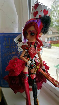 Lizzie Hearts as the Queen of Hearts. She's super crazy hard to pose in her card armor. XD