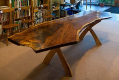 From a black walnut tree in Stony Creek, we made this wooden slab table with a very nice finish.