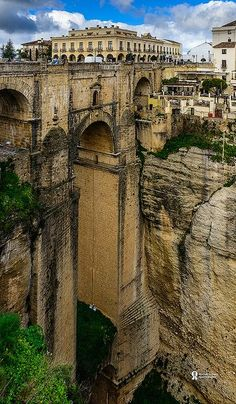 "Puente Nuevo - Ronda, Spain ... ""The Puente Nuevo is the newest and largest of three bridges that span the chasm that carries the Guadalevín River and divides the city of Ronda, in southern Spain. Construction of the bridge began in 1751, took a total of 42 years to complete, and claimed the lives of 50 builders. There is a chamber beneath the central arch that was used for a variety of purposes, including as a prison."""