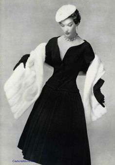 Model wearing a dress with stole by Dior, 1954. S)