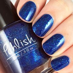 Pahlish - Winter 2014 - Snow Over the Rhone.  A bright cobalt blue linear holographic packed with platinum silver flakes!
