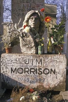 Jim Morrison's grave in Paris - it would be sooooo awesome to visit here!!