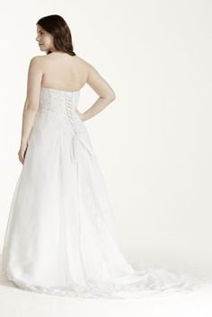 Strapless beaded lace chiffon side drape with satin split front.   Chapel train. Lace up Back.  Sizes: 14W-26W. Available in Ivory and White .  To preserve your wedding dreams, try our Wedding Gown Preservation Kit.