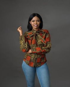 Step up your fashion game in this simple yet classy top. It could be dressed up in a pencil skirt and heels for work or make it casual chic with a pair of jeans & flats! Self -tie pussy bow detail Back zipper African Fashion Designers, African Fashion Ankara, Latest African Fashion Dresses, African Print Dresses, African Print Fashion, Africa Fashion, African Dress, Ankara Tops Blouses, African Blouses