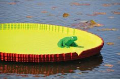 Giant water lily with frog, sculptures by Sean Kenney