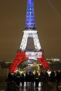 On red alert: The tower was reopened but heavy security presence remained on the streets of Paris this evening