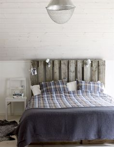 rustic wood headboard in scandinavian bedroom