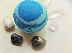 Handmade bath bomb with artisan fragrance. A delicate and bright blend of Jasmine, Rose, Neroli and Violets set against a clear sunny blue sky. This gentle fizzing blue ball will leave you singing Blue Skies for the rest of the day. $4.44
