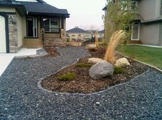 No Maintenance Back Yard | front yard xeriscaped back yard mulch and boulders easy maintenance ...