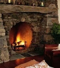 han in the glow of a hobbit-inspired hearth? Pictured above, left, is a fireplace design with a round (firebox) opening -- a hallmark of window and door shapes in hobbit house architecture. Rounded stones and curved edges evoke the Cozy Fireplace, Fireplace Design, Fireplace Ideas, Bedroom Fireplace, Cottage Fireplace, Library Fireplace, Fireplace Garland, Fireplace Candles, Slate Fireplace