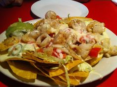 Mexican Chain Restaurant Recipes: Chi Chi's Seafood Nachos -- This was my FAVORITE item on the Chi Chi's menu when I was in college! I have to re-create this ... maybe without all the fakey seafood though ;)
