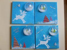 """peintures sur toile pour décorer la maison  : 1 étaler la peinture déposée par l'enseignante sur la toile et les bords avec ses mains. 2- choix de faire un pochoir (flocon ou renne) ou de placer des sapins  3- choisir une figurine en bois qui sera """"recouverte par une demi boule en plastique dans laquelle un peu de neige artificielle a été déposée. 4- choix du souhait (bonne année/ joyeux Noël/ etc) et d'une petite figurine ou sticker à ajouter."""