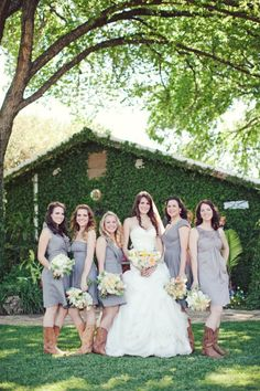 cowboy boots + gray dresses | Photography by jnicholsphoto.com | Event Coordination by thesimplifiers.com | Floral + Event Design by thenouveauromantics.com | Read more - http://www.stylemepretty.com/2013/07/08/austin-wedding-from-the-nichols-2/