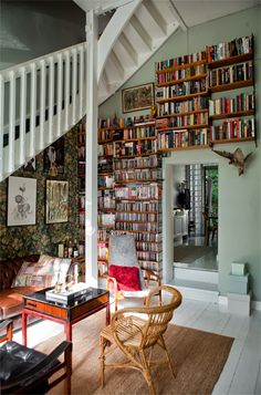 This is so awesome! I love the bookshelves because they are floating so they wouldn't take too much space, but the way they are arranged still looks fairly traditional. Perfect! Now to run out and buy a whole bunch of bookshelves...