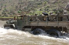 M-813 5-ton, 6x6 truck full of U.S. Army soldiers fords the Pech River in Pech Valley, Afghanistan, during operations, 9 April 2006. The soldiers are attached to Charlie Company, 1st Battalion, 32nd Infantry Regiment.