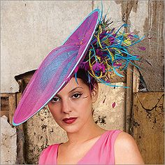 The Vault is a fascinator designed by Vivien Sheriff. This fascinator is constructed with straw, feather, and features multicolored Swarovski crystals. The hat comes in Teal and Fuchsia. The hat is perfect to show off at the Kentucky Derby races! English Hats, Coque Feathers, Ostrich Feathers, Fascinator Hats, Fascinators, Hat Day, Bonnet Hat, Hat Stands, Church Hats