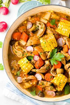 Beer-Braised Chicken Stew - A hearty recipe loaded with vegetables, potatoes, carrots, corn and fresh herbs. | jessicagavin.com