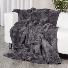 ee30377123 The rabbit fur blanket is constructed with real full rabbit fur pelts. It  is a