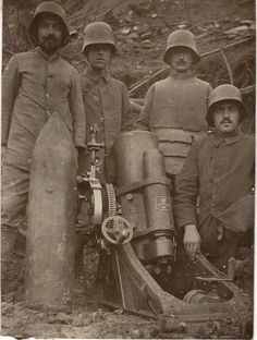 A German crew pose by what looks like a 170mm minenwerfer. The soldier in the body armor may be a forward artillery observer for this mortar unit.
