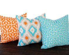 Set of three decorative throw pillow covers in medium grey, light grey, orange, aqua-turquoise, and natural. This fabric is printed on lightweight striated (has furrows or linear markings similar to linen) cotton duck. These covers are so gorgeous in person! Features: >Deep envelope closure so that inserts are not visible >Same print on front and back >Serged for a professional finish and to keep seams from fraying >High quality, durable thread >Professionally attached care tag...