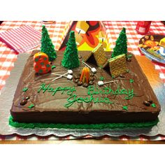 Camping birthday cake. Simple for the masses. I really like the fire idea. Maybe green frosting instead of brown?