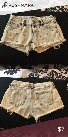Jean shorts Washed out blue jean shorts with silver embroidered metal beads on front Decree Shorts Jean Shorts