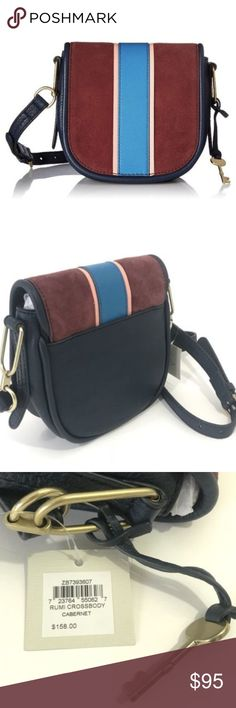"""Fossil Rumi Small Crossbody Bag Navy Racer NWT!! Inspired by athleisure, the embellished leather rumi boasts a striped design, round shape and signature front flap. Adorable gold key design on the side with the words 'FOSSIL' embeliished on it. Adds a cute touch to the bag!! Adjustable straps for your comfort  Features  • Leather  • Cotton lining  • Flap closure  • Measurements: 8""""L x 3""""W x 7""""H  • Interior details: 1 zipper pocket  • Handle drop: 22"""" strap when fully extended Fossil Bags…"""