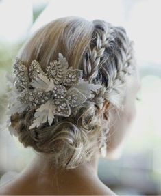 Winter wedding hair up-do. Plaits and beautiful hair piece.