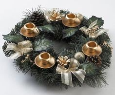The festive bows and gold and natural pinecones Traditional Pine Cone Advent Wreath coordinate beautifully with your rustic Christmas decor.