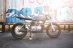 Honda CB750 SOHC cafe custom with relocated rear shock mounts
