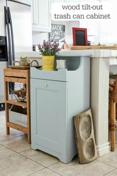Often crafted from wood, these clever concealers add a country-chic accent to a kitchen, and the handheld tilt-out design means your bin is always easily within reach. Hidden Trash Can Kitchen, Kitchen Garbage Can Storage, Kitchen Trash Cans, Wood Trash Can, Kitchen Furniture, Diy Furniture, Furniture Projects, Furniture Plans, Painted Furniture