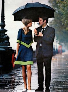 A stylish couple in the rain in London (1963).
