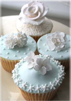 Beautiful Cake Pictures: Pretty Pale Blue Icing Cupcakes With Sugar Flowers - Cupcake, Flower Cupcakes - Flowers Cupcakes, Fancy Cupcakes, White Cupcakes, Pretty Cupcakes, Beautiful Cupcakes, Yummy Cupcakes, Wedding Cupcakes, Shabby Chic Cupcakes, Decorate Cupcakes