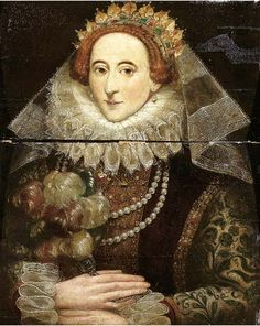 Portrait of Queen Elizabeth I of England (1533-1603), half length, wearing a green embroidered gold brocade jacket with a red velvet vlieger, set with precious stones and jewelry, with lace collar, cuffs and veil. Oil on panel after Federico Zucchero.