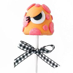 Orange-and-Pink Monster Brownie Pop        This sassy Monster Brownie Pop has a flirty flair.