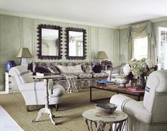 "In the chapter on timelessness in interiors, the duo start to explain how they arrive at ""the mix."" For example, in Anna Wintour's country house living room (not identified but recognizable), bold choices in scale and pattern offset quieter moments. Shiny white enameled floors sit under the rough rustic texture of sea grass and formal traditional curtains are of a contemporary fabric."