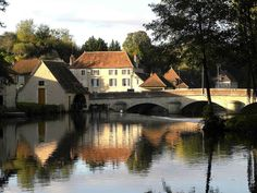 A view of La Trimouille with the old mill (medieval) and the bridge over the Benaize