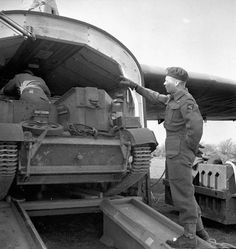 Lt. Simpson loads Bren Gun Carrier into Hamilcar glider 18 March 1945