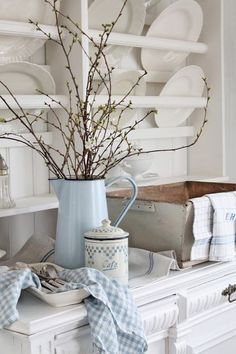 Shabby Chic white kitchen. I have an enamel pitcher I am going to spray paint today & add flowers...inspired!