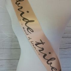 Blush bachelorette party sash for bride-to-be and brides tribe to wear. Personalized free. Fast shipping !  Comes with a rhinestone safety pin for closure. Order one for every member of the bridal party.