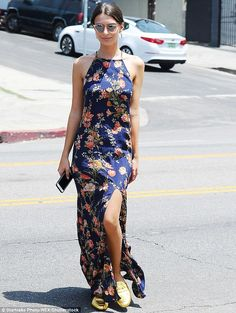 Golden feet: Emily Ratajkowski wore a floral print halter dress and golden flats on Friday...