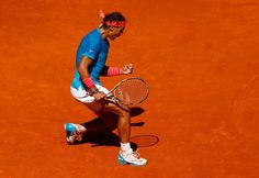 Rafael Nadal of Spain celebrates a point against Tomas Berdych in the semi finals during day eight of the Mutua Madrid Open tennis tournament at the Caja Magica on May 9, 2015 in Madrid.