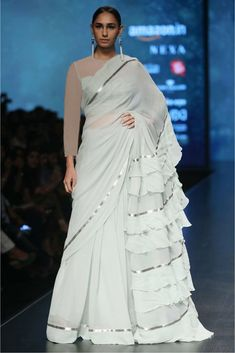 The Stylish And Elegant Ruffle Saree In Off White Colour Looks Stunning And Gorgeous With Trendy And Fashionable Georgette Fabric Looks Extremely Attractive And Can Add Charm To Any Occasion. Trendy Sarees, Stylish Sarees, Fancy Sarees, Indian Dresses, Indian Outfits, Saree Gown, Lehenga Saree, Bridal Lehenga, Modern Saree